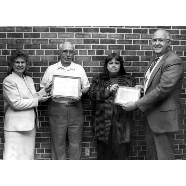 1992 - School Volunteer Work Awards Left: Loretta Hoverston awarding Paul Rouse with the Outstanding School Volunteer Award - Right: Jim Stillman awarding Judy Ecker with the Citizen Partner of the Year Award